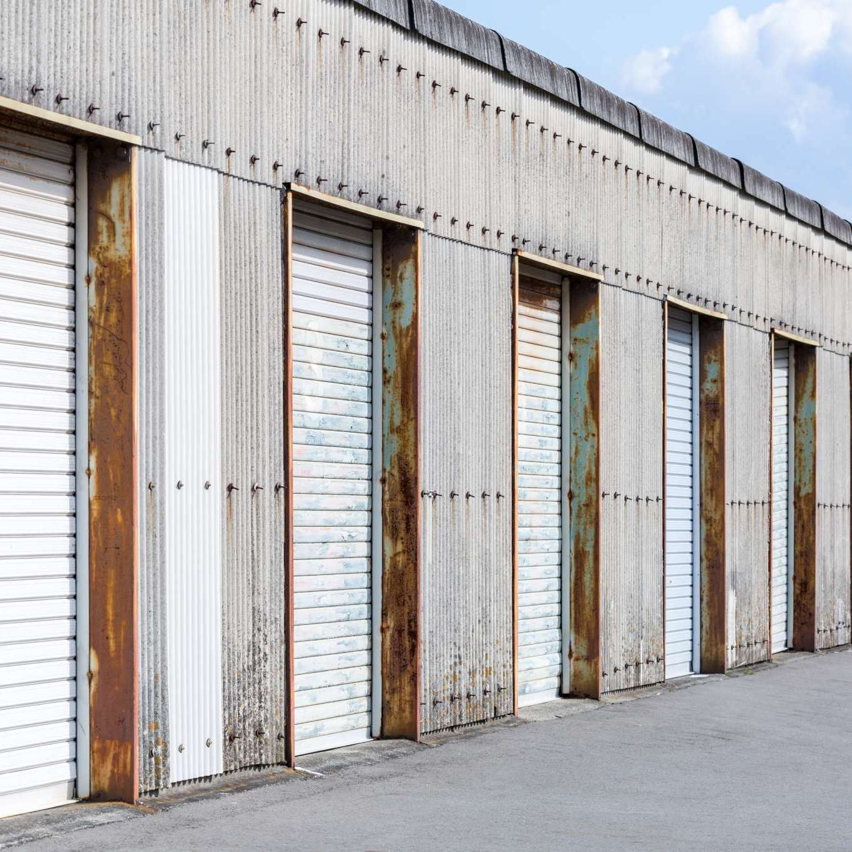 Self Storage Unit Shutter door or roller door of factory building use for industrial background.